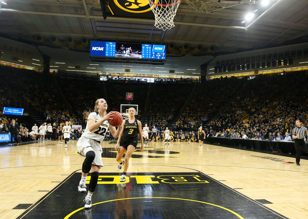 Iowa Hawkeyes guard Kathleen Doyle (22) scores a basket after a steal during the first quarter of their second round game in the 2019 NCAA Women's Basketball Tournament at Carver Hawkeye Arena in Iowa City on Sunday, Mar. 24, 2019. (Stephen Mally for hawkeyesports.com)