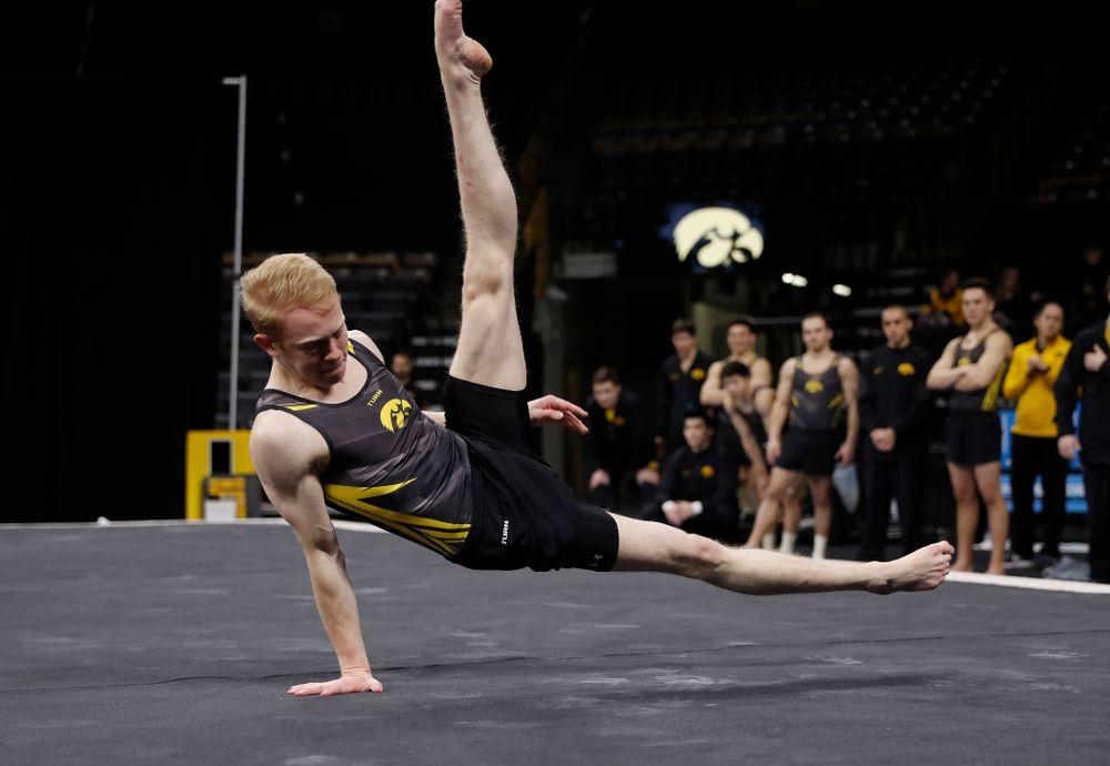 Nick Merryman competes on the floor against Illinois