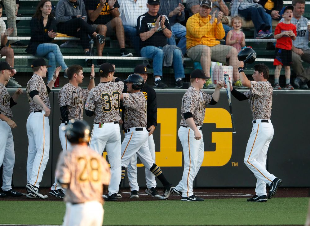 Iowa Hawkeyes outfielder Ben Norman (9) celebrates after scoring during the Iowa Hawkeyes game against Oklahoma State Friday, May 4, 2018 at Duane Banks Field. (Brian Ray/hawkeyesports.com)
