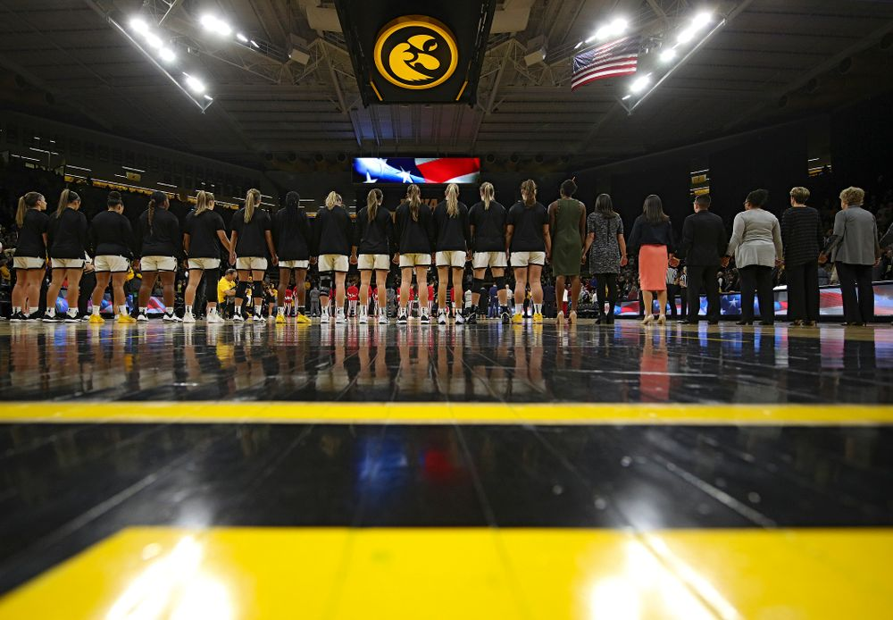 The Hawkeyes stand for the National Anthem before the start of their game at Carver-Hawkeye Arena in Iowa City on Sunday, January 12, 2020. (Stephen Mally/hawkeyesports.com)