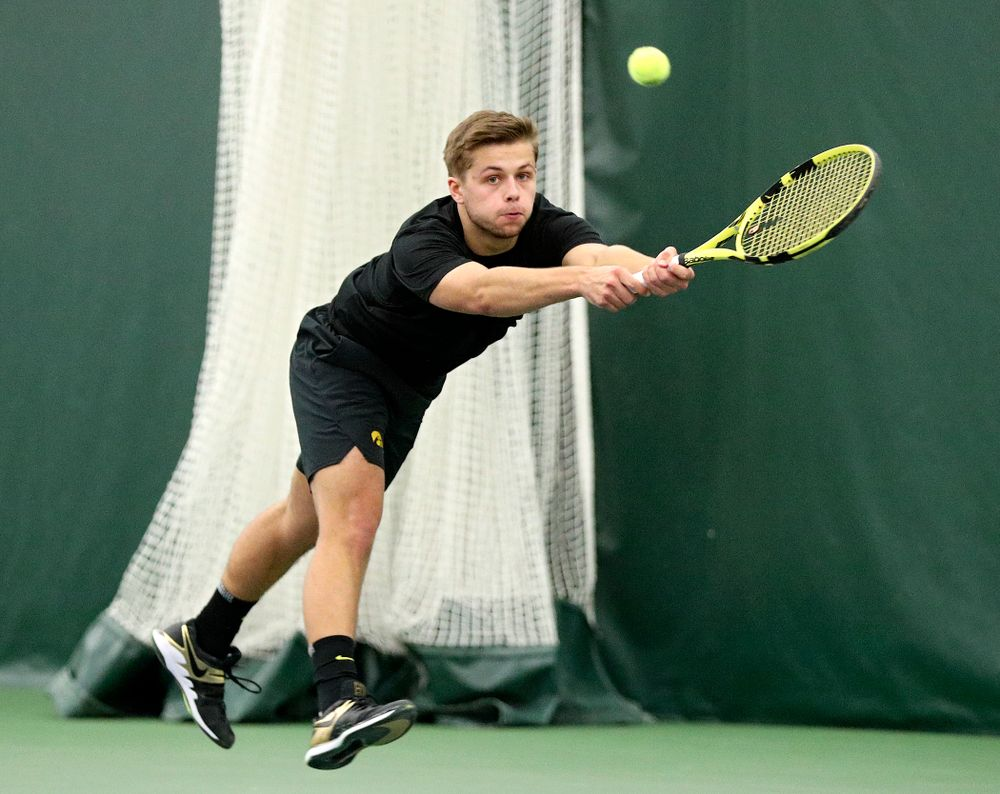 Iowa's Will Davies reaches for a ball during his doubles match at the Hawkeye Tennis and Recreation Complex in Iowa City on Friday, February 14, 2020. (Stephen Mally/hawkeyesports.com)