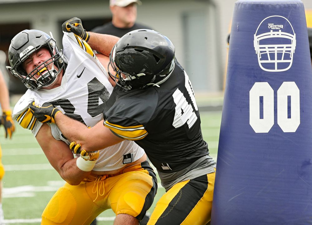 Iowa Hawkeyes linebacker Kristian Welch (34) and fullback Turner Pallissard (40) run a drill during Fall Camp Practice No. 10 at the Hansen Football Performance Center in Iowa City on Tuesday, Aug 13, 2019. (Stephen Mally/hawkeyesports.com)