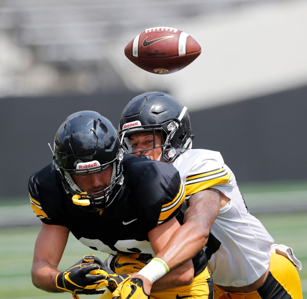 Iowa Hawkeyes wide receiver Nico Ragaini (89) and defensive back Julius Brents (20) during Kids Day Saturday, August 11, 2018 at Kinnick Stadium. (Brian Ray/hawkeyesports.com)
