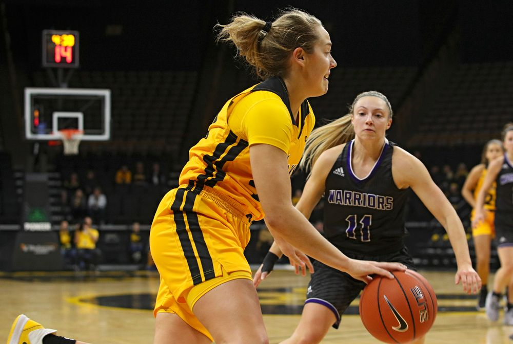 Iowa guard Kathleen Doyle (22) drives in with the ball during the first quarter of their game against Winona State at Carver-Hawkeye Arena in Iowa City on Sunday, Nov 3, 2019. (Stephen Mally/hawkeyesports.com)