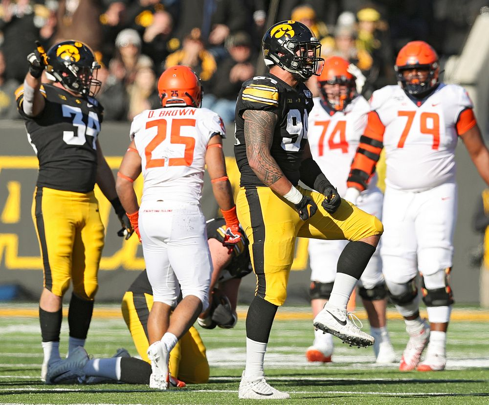 Iowa Hawkeyes defensive end A.J. Epenesa (94) celebrates a tackle during the third quarter of their game at Kinnick Stadium in Iowa City on Saturday, Nov 23, 2019. (Stephen Mally/hawkeyesports.com)