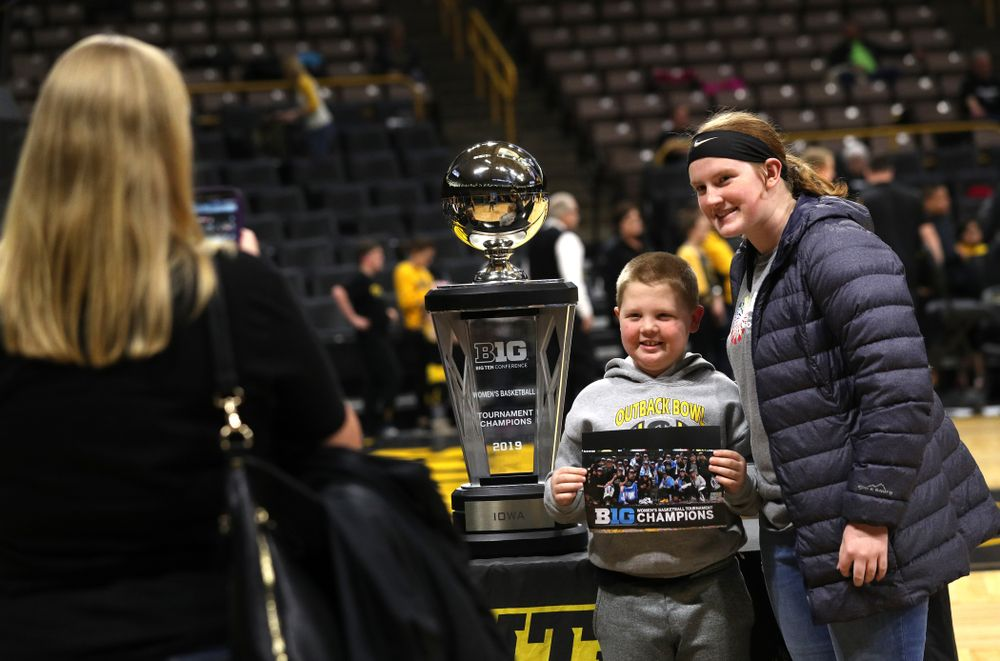 Fans take photos with the Big Ten Championship Trophy during a celebration of the Iowa Hawkeyes Big Ten Women's Basketball Tournament championship Monday, March 18, 2019 at Carver-Hawkeye Arena. (Brian Ray/hawkeyesports.com)