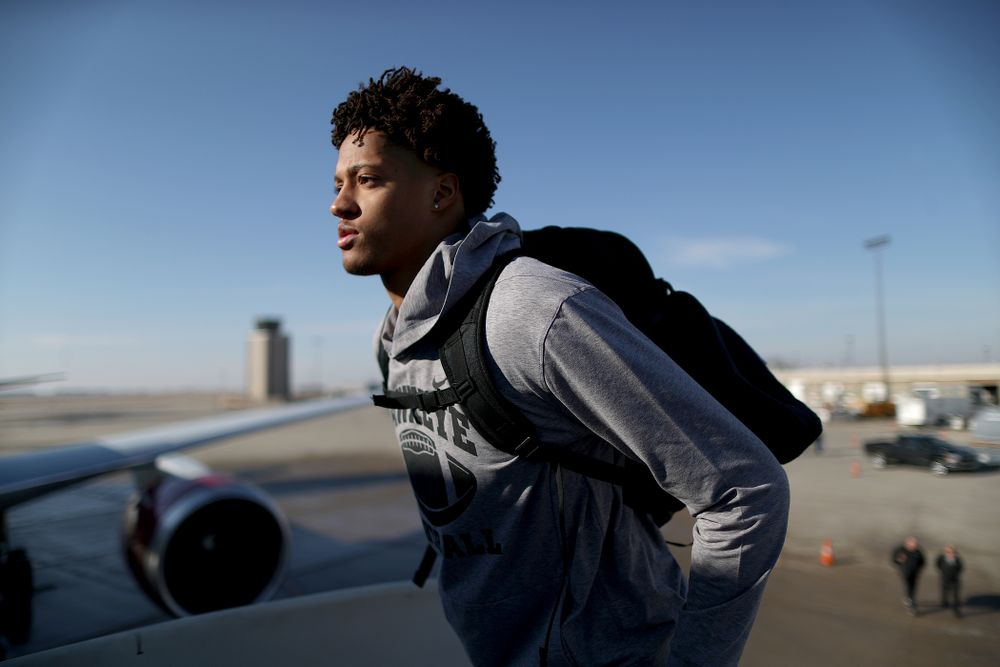Iowa Hawkeyes defensive back Julius Brents (20) boards the team plane at the Eastern Iowa Airport Saturday, December 21, 2019 on the way to San Diego, CA for the Holiday Bowl. (Brian Ray/hawkeyesports.com)