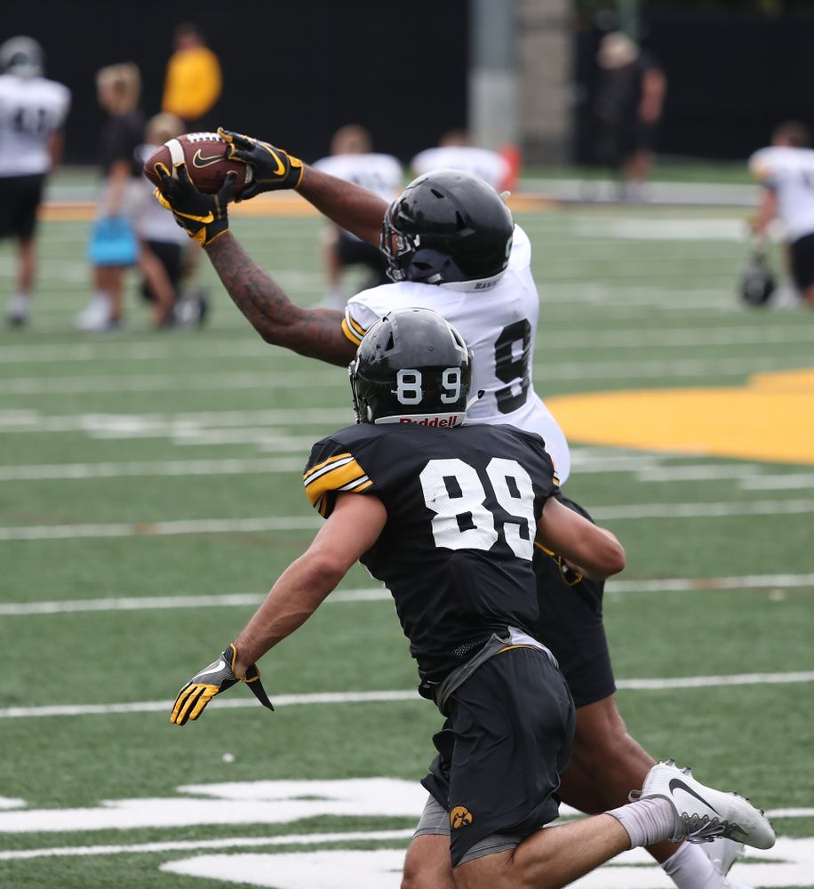 Iowa Hawkeyes defensive back Geno Stone (9) and wide receiver Nico Ragaini (89) during practice No. 4 of Fall Camp Monday, August 6, 2018 at the Hansen Football Performance Center. (Brian Ray/hawkeyesports.com)