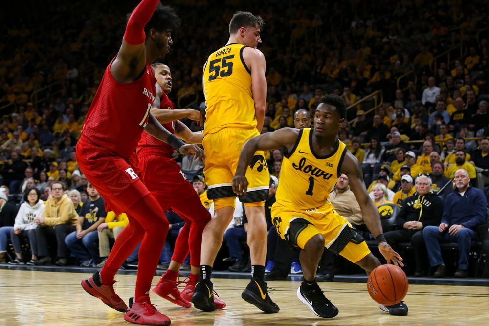 Iowa Hawkeyes guard Joe Toussaint (1) drives to the basket during the Iowa men's basketball game vs Rutgers on Wednesday, January 22, 2020 at Carver-Hawkeye Arena. (Lily Smith/hawkeyesports.com)