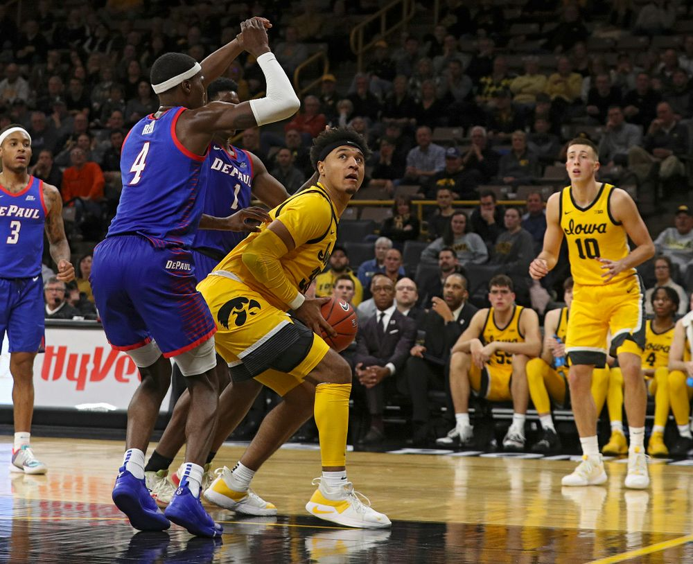 Iowa Hawkeyes forward Cordell Pemsl (35) eyes the basket during the second half of their game at Carver-Hawkeye Arena in Iowa City on Monday, Nov 11, 2019. (Stephen Mally/hawkeyesports.com)