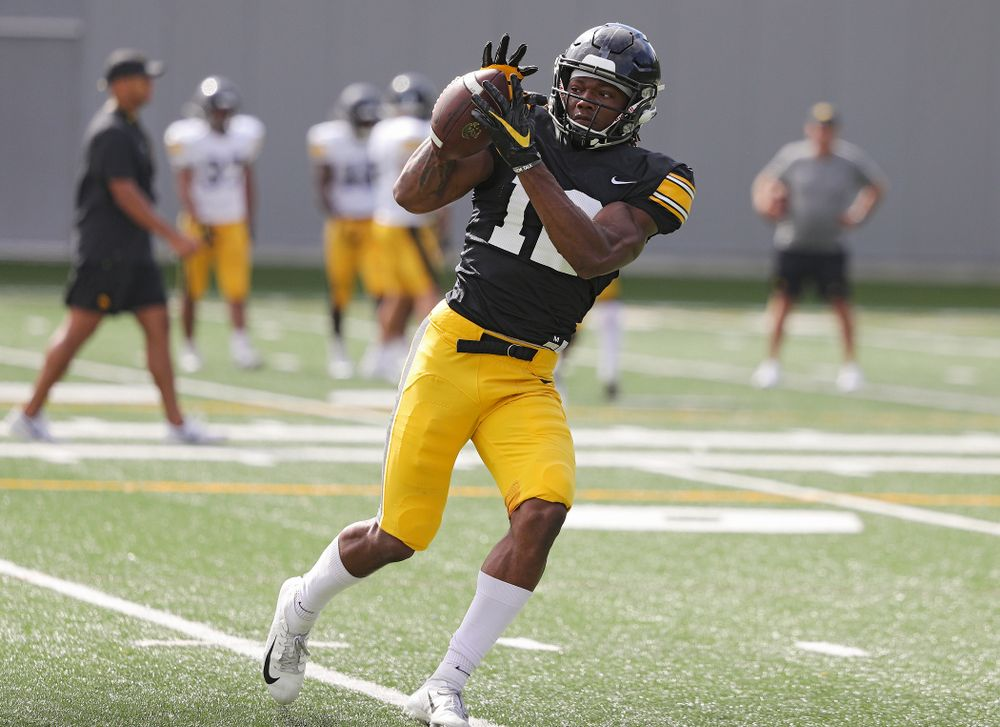 Iowa Hawkeyes wide receiver Brandon Smith (12) pulls in a pass during Fall Camp Practice No. 11 at the Hansen Football Performance Center in Iowa City on Wednesday, Aug 14, 2019. (Stephen Mally/hawkeyesports.com)