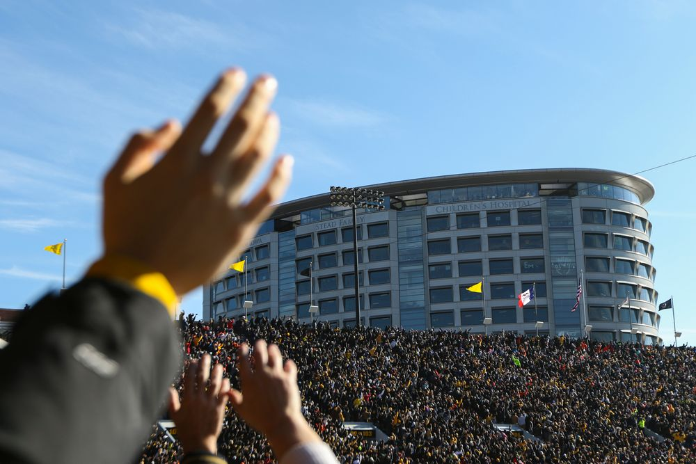 Iowa fans participate in The Wave during Iowa football vs Illinois on Saturday, November 23, 2019 at Kinnick Stadium. (Lily Smith/hawkeyesports.com)