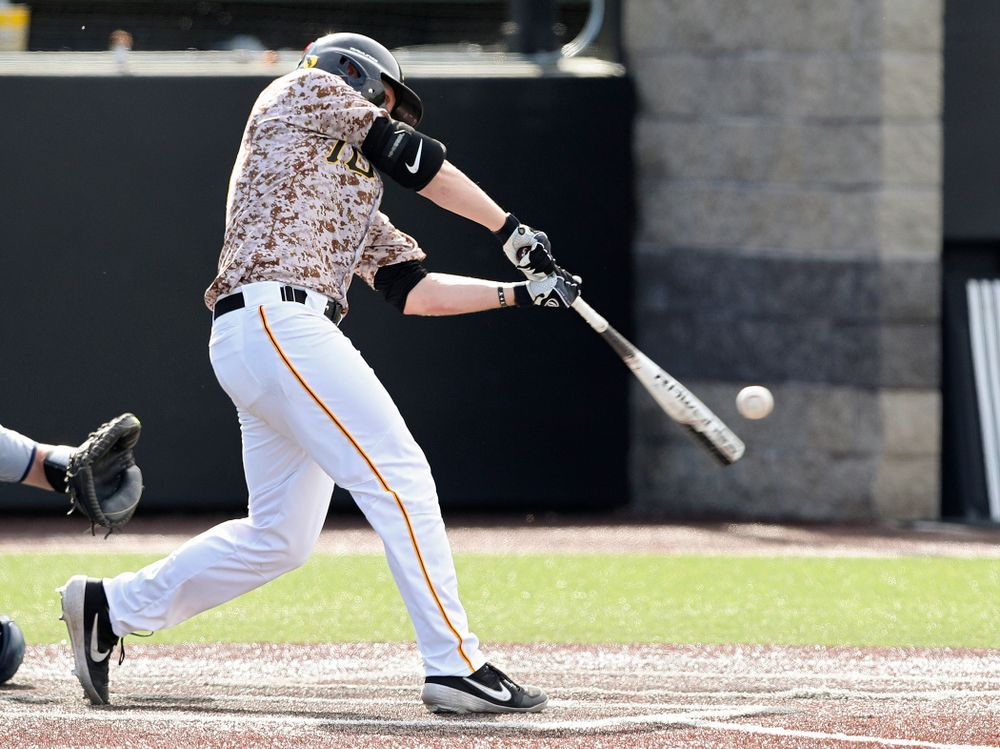 Iowa Hawkeyes first baseman Zeb Adreon (5) drives a pitch for a hit during the ninth inning of their game against UC Irvine at Duane Banks Field in Iowa City on Sunday, May. 5, 2019. (Stephen Mally/hawkeyesports.com)