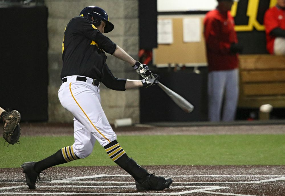 Iowa designated hitter Trenton Wallace (38) drives a pitch for a hit during the seventh inning of their game at Duane Banks Field in Iowa City on Tuesday, March 3, 2020. (Stephen Mally/hawkeyesports.com)