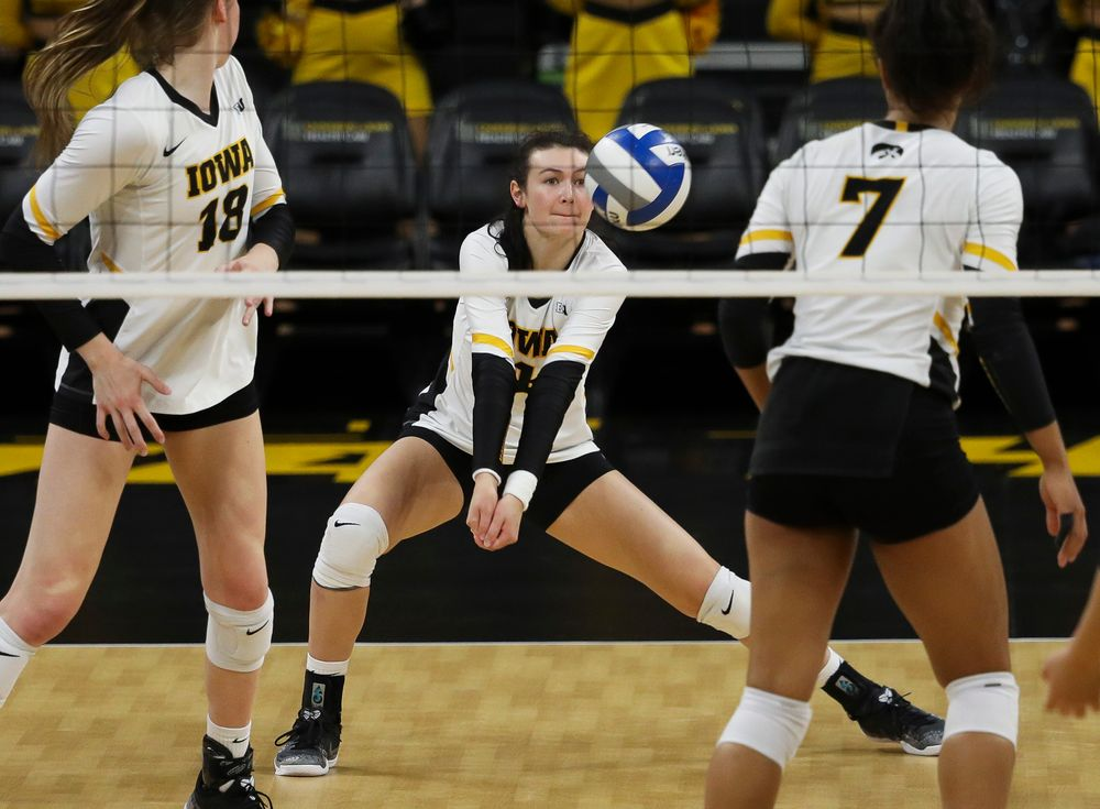 Iowa Hawkeyes defensive specialist Halle Johnston (4) digs the ball during a match against Maryland at Carver-Hawkeye Arena on November 23, 2018. (Tork Mason/hawkeyesports.com)