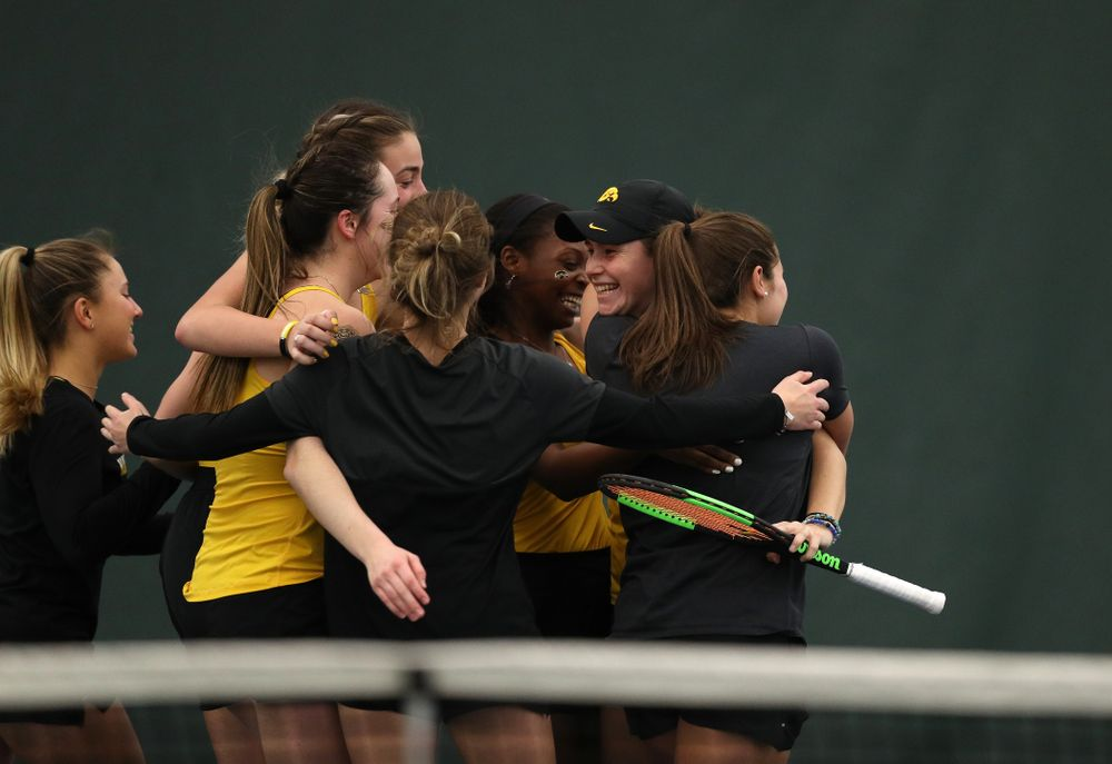 Iowa's Elise Van Heuvelen celebrates with her teammates following their 4-1 win over the Iowa State Cyclones Friday, February 8, 2019 at the Hawkeye Tennis and Recreation Complex. (Brian Ray/hawkeyesports.com)