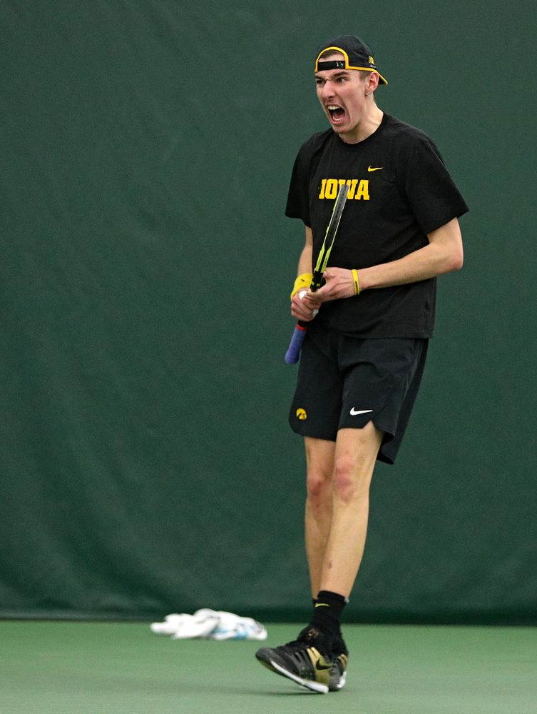 Iowa's Nikita Snezhko celebrates a point during his singles match at the Hawkeye Tennis and Recreation Complex in Iowa City on Friday, March 6, 2020. (Stephen Mally/hawkeyesports.com)