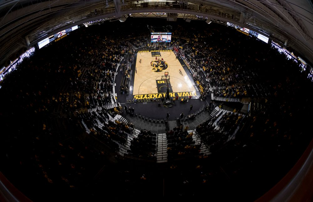 Iowa Hawkeyes forward Tyler Cook (5) goes up for the opening tip off