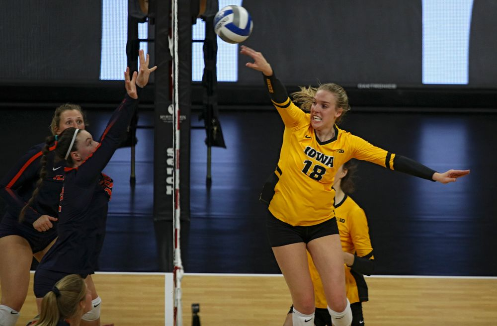 Iowa's Hannah Clayton (18) gets a kill during the second set of their match against Illinois at Carver-Hawkeye Arena in Iowa City on Wednesday, Nov 6, 2019. (Stephen Mally/hawkeyesports.com)