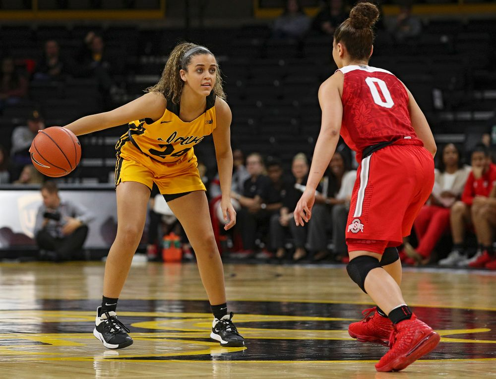 Iowa Hawkeyes guard Gabbie Marshall (24) dribbles the ball during the third quarter of their game at Carver-Hawkeye Arena in Iowa City on Thursday, January 23, 2020. (Stephen Mally/hawkeyesports.com)