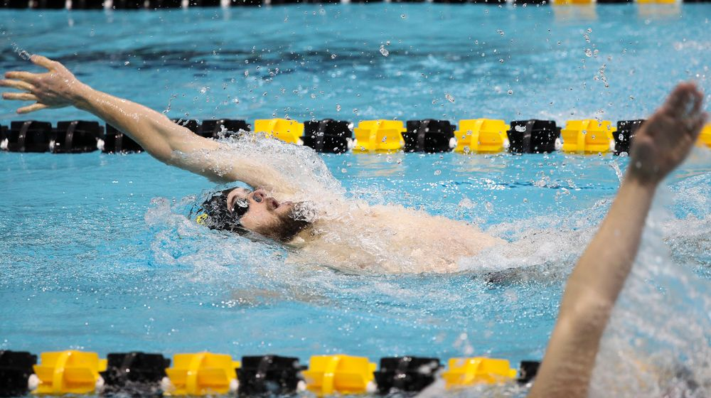 Iowa's Kenneth Mende competes in the 200-yard backstroke during a meet against Michigan and Denver at the Campus Recreation and Wellness Center on November 3, 2018. (Tork Mason/hawkeyesports.com)