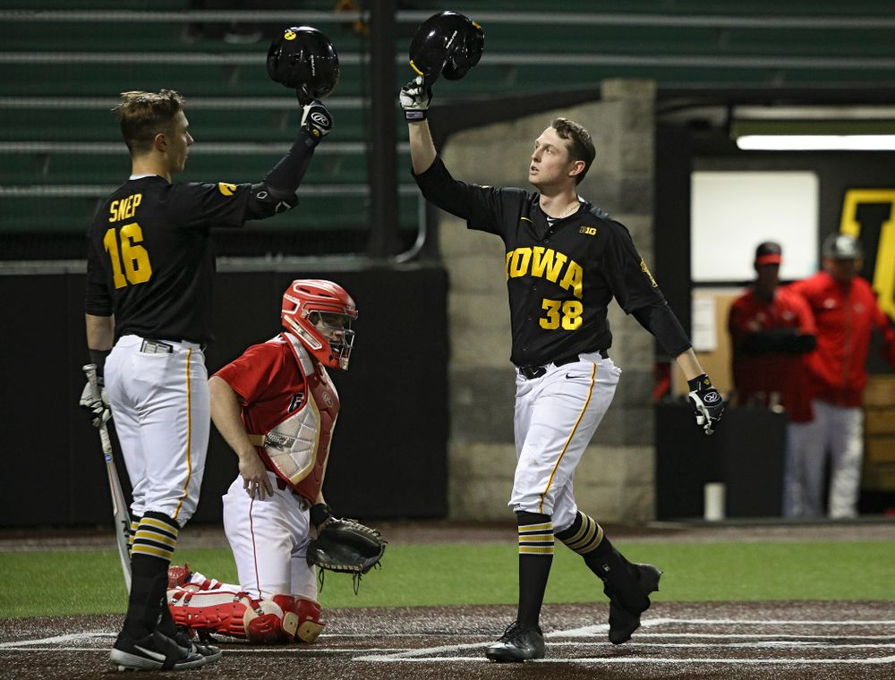 Iowa designated hitter Trenton Wallace (38) is greeted by catcher Tyler Snep (16) after hitting a home run during the eighth inning of their game at Duane Banks Field in Iowa City on Tuesday, March 3, 2020. (Stephen Mally/hawkeyesports.com)