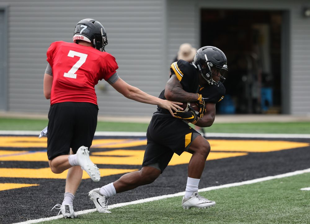 Iowa Hawkeyes quarterback Spencer Petras (7) and running back Mekhi Sargent during practice No. 4 of Fall Camp Monday, August 6, 2018 at the Hansen Football Performance Center. (Brian Ray/hawkeyesports.com)