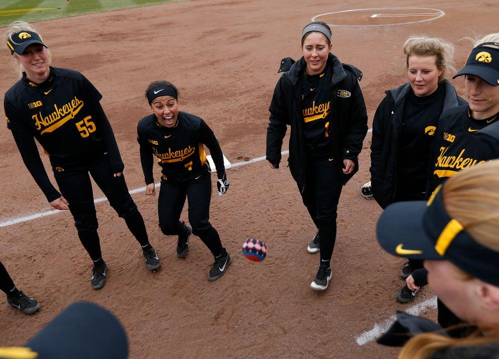 Iowa Hawkeyes outfielder McKenzie Schneider (55), Iowa Hawkeyes infielder Lea Thompson (7), Iowa Hawkeyes infielder Elizabeth DeShields (19)