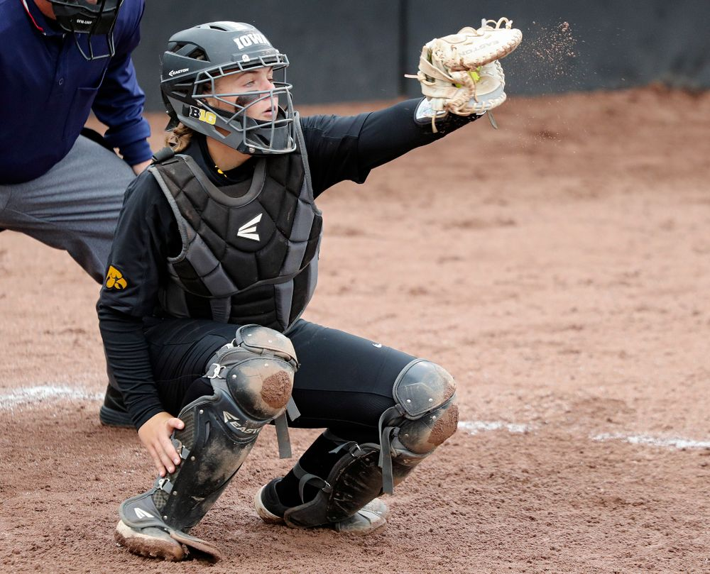 Iowa catcher Abby Lien (9) eyes a pitch during the fifth inning of their game against Iowa Softball vs Indian Hills Community College at Pearl Field in Iowa City on Sunday, Oct 6, 2019. (Stephen Mally/hawkeyesports.com)