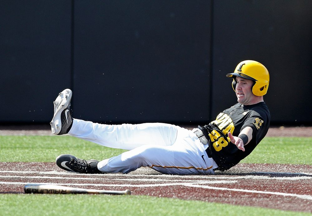 Iowa Hawkeyes left fielder Chris Whelan (28) scores a run during the first inning of their game against Rutgers at Duane Banks Field in Iowa City on Saturday, Apr. 6, 2019. (Stephen Mally/hawkeyesports.com)