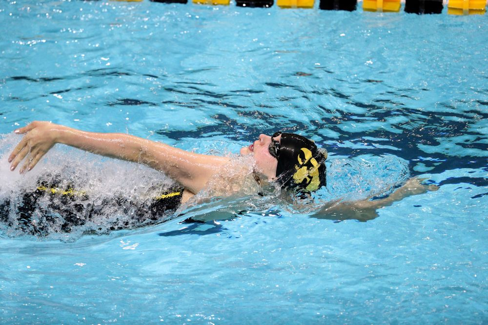 Iowa's Hannah Burvill swims the backstroke leg of the 200-yard medley relay against the Iowa State Cyclones in the Iowa Corn Cy-Hawk Series Friday, December 7, 2018 at at the Campus Recreation and Wellness Center. (Brian Ray/hawkeyesports.com)