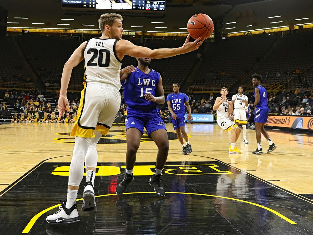 Iowa Hawkeyes forward Riley Till (20) grabs a pass during the second half of their exhibition game against Lindsey Wilson College at Carver-Hawkeye Arena in Iowa City on Monday, Nov 4, 2019. (Stephen Mally/hawkeyesports.com)