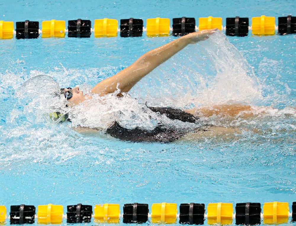 Iowa's Hannah Burvill swims the women's 100-yard backstroke event during their meet against Michigan State and Northern Iowa at the Campus Recreation and Wellness Center in Iowa City on Friday, Oct 4, 2019. (Stephen Mally/hawkeyesports.com)
