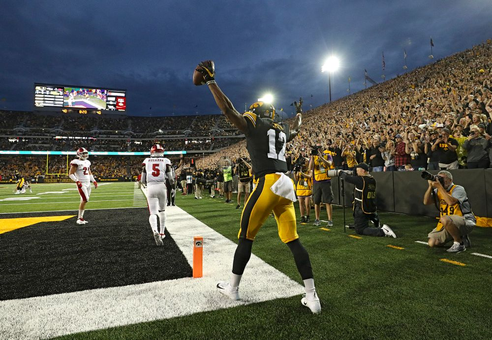 Iowa Hawkeyes wide receiver Brandon Smith (12) celebrates after scoring a touchdown during the second quarter of their game at Kinnick Stadium in Iowa City on Saturday, Aug 31, 2019. (Stephen Mally/hawkeyesports.com)