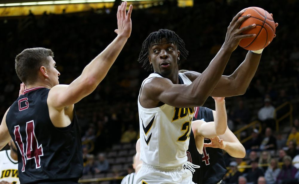 Iowa Hawkeyes forward Tyler Cook (25) gathers himself under the basket during a game against Guilford College at Carver-Hawkeye Arena on November 4, 2018. (Tork Mason/hawkeyesports.com)