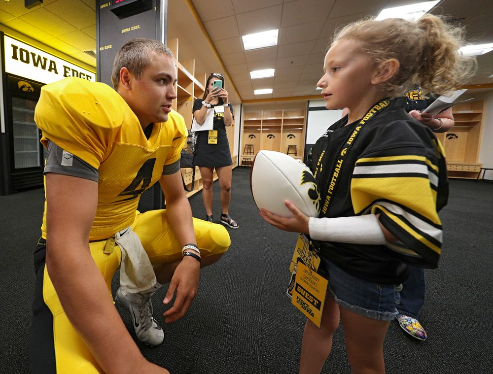 Iowa Hawkeyes quarterback Nate Stanley (4) talks with Kid Captain Charlotte Keller during Kids Day at Kinnick Stadium in Iowa City on Saturday, Aug 10, 2019. (Stephen Mally/hawkeyesports.com)