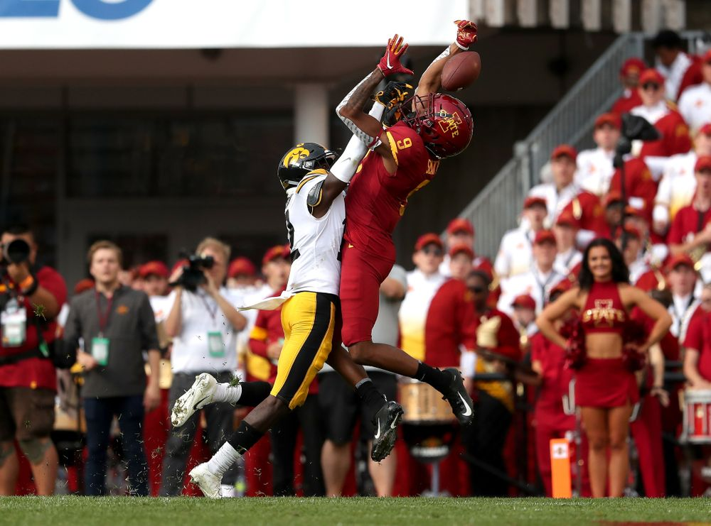 Iowa Hawkeyes defensive back D.J. Johnson (12) breaks up a pass intended for wide receiver Joseph Scates (9) Saturday, September 14, 2019 at Jack Trice Stadium in Ames, Iowa. (Brian Ray/hawkeyesports.com)