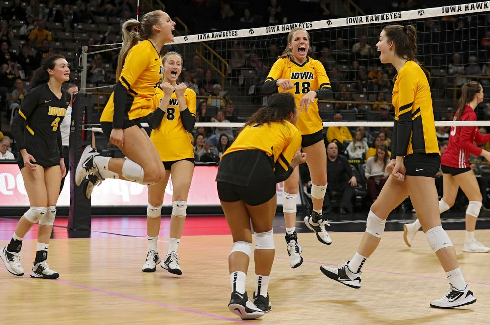 Iowa's Halle Johnston (4), Maddie Slagle (15), Kyndra Hansen (8), Brie Orr (7), Hannah Clayton (18), and Courtney Buzzerio (2) celebrate a score during their match at Carver-Hawkeye Arena in Iowa City on Sunday, Oct 20, 2019. (Stephen Mally/hawkeyesports.com)