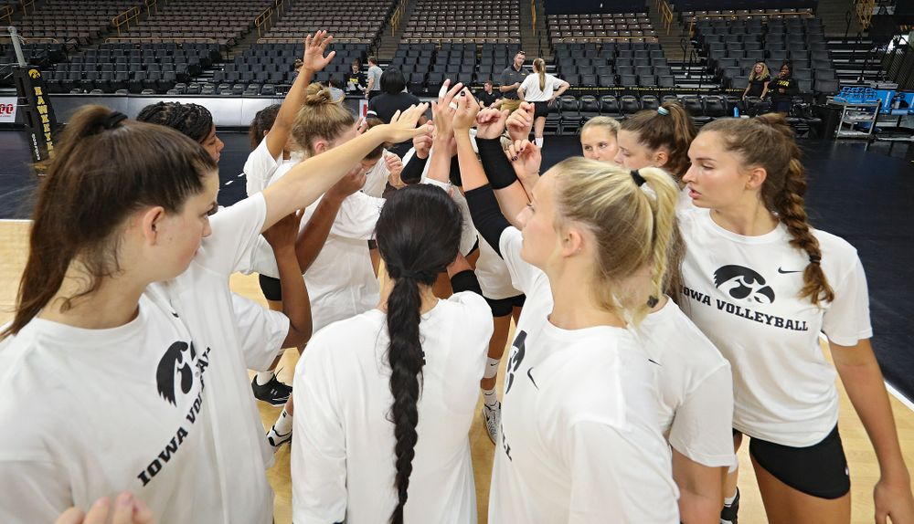 The Iowa Hawkeyes huddle during Iowa Volleyball's Media Day at Carver-Hawkeye Arena in Iowa City on Friday, Aug 23, 2019. (Stephen Mally/hawkeyesports.com)