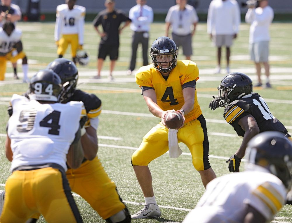 Iowa Hawkeyes quarterback Nate Stanley (4) prepares to hand off to running back Mekhi Sargent (10) during Fall Camp Practice #5 at the Hansen Football Performance Center in Iowa City on Tuesday, Aug 6, 2019. (Stephen Mally/hawkeyesports.com)