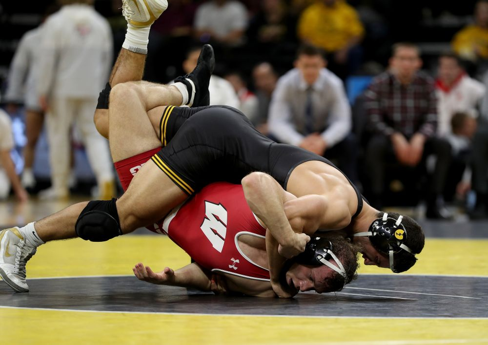 IowaÕs Michael Kemerer wrestles WisconsinÕs Jared Krattinger at 174 pounds Sunday, December 1, 2019 at Carver-Hawkeye Arena. Kemerer won the match with a fall. (Brian Ray/hawkeyesports.com)