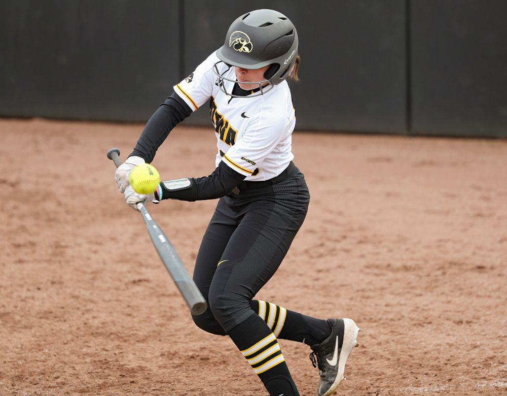 Iowa's Alex Rath (23) gets a hit during the fifth inning of their game against Illinois at Pearl Field in Iowa City on Friday, Apr. 12, 2019. (Stephen Mally/hawkeyesports.com)