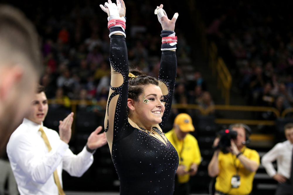 Iowa's Erin Castle competes on the bars during their meet against Southeast Missouri State Friday, January 11, 2019 at Carver-Hawkeye Arena. (Brian Ray/hawkeyesports.com)
