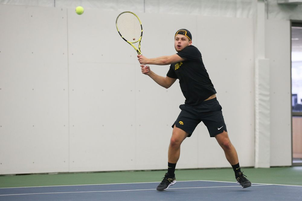 Iowa's Will Davies returns a hit during the Iowa men's tennis meet vs VCU  on Saturday, February 29, 2020 at the Hawkeye Tennis and Recreation Complex. (Lily Smith/hawkeyesports.com)