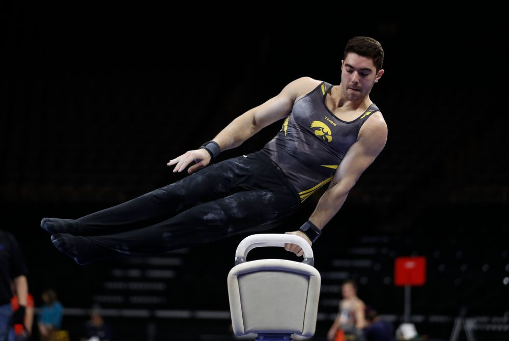 Dominic Tommaso competes on the pommel horse against Illinois