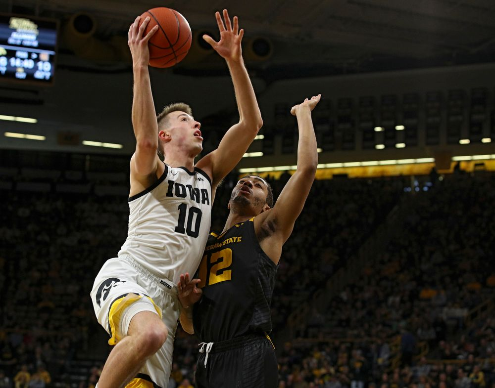 Iowa Hawkeyes guard Joe Wieskamp (10) scores a basket during the first half of their their game at Carver-Hawkeye Arena in Iowa City on Sunday, December 29, 2019. (Stephen Mally/hawkeyesports.com)
