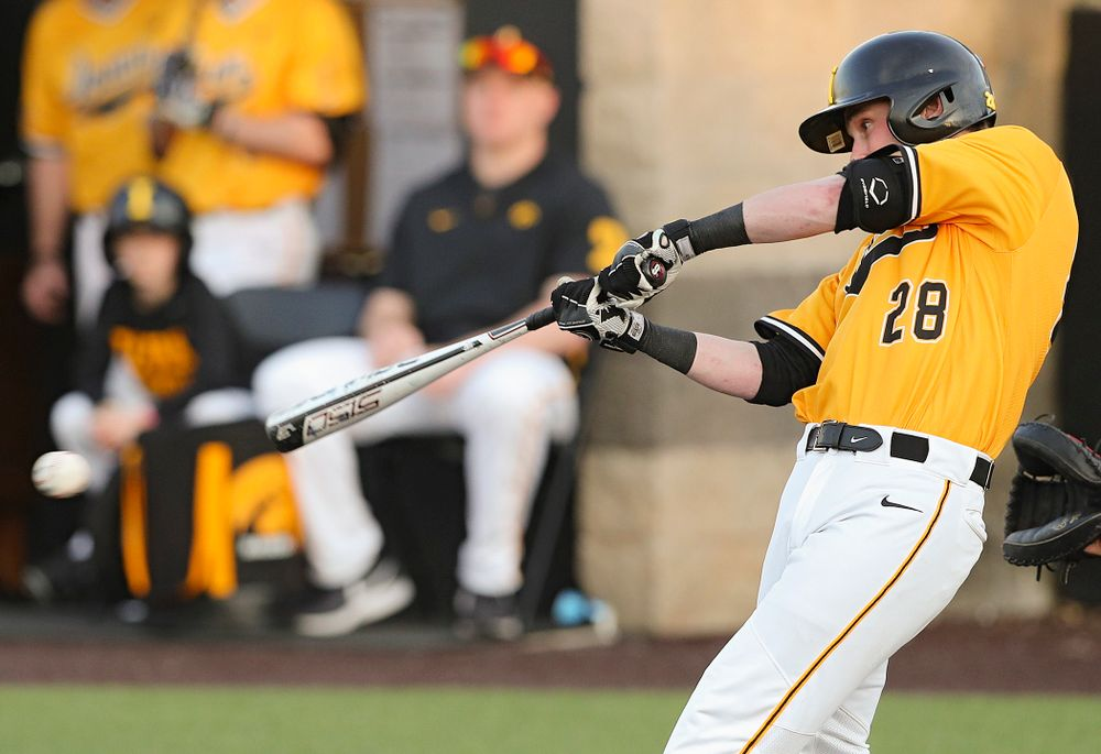 Iowa Hawkeyes left fielder Chris Whelan (28) gets a hit during the eighth inning of their game against Northern Illinois at Duane Banks Field in Iowa City on Tuesday, Apr. 16, 2019. (Stephen Mally/hawkeyesports.com)