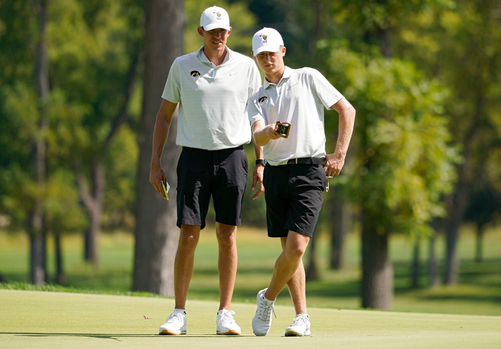 Iowa assistant coach Charlie Hoyle (from left) talks with  Benton Weinberg during the second day of the Golfweek Conference Challenge at the Cedar Rapids Country Club in Cedar Rapids on Monday, Sep 16, 2019. (Stephen Mally/hawkeyesports.com)