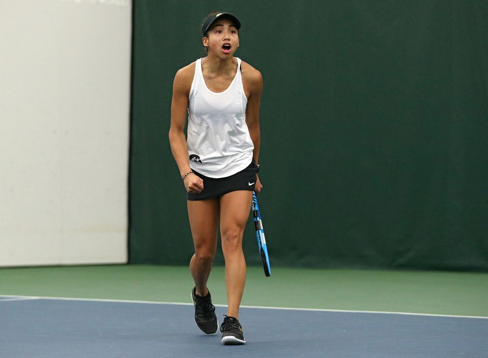 Iowa's Michelle Bacalla celebrates after winning a game during her singles match at the Hawkeye Tennis and Recreation Complex in Iowa City on Sunday, February 23, 2020. (Stephen Mally/hawkeyesports.com)