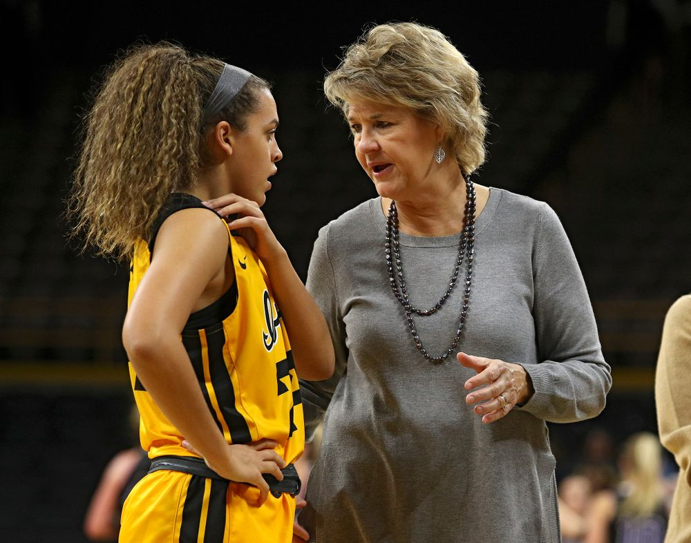 Iowa guard Gabbie Marshall (24) talks with head coach Lisa Bluder during the third quarter of their game against Winona State at Carver-Hawkeye Arena in Iowa City on Sunday, Nov 3, 2019. (Stephen Mally/hawkeyesports.com)